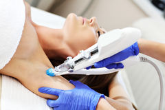 Woman having armpit mesotherapy in beauty salon Royalty Free Stock Photos