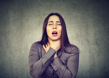 Woman having asthma attack or choking can`t breath suffering from respiration problems. Young woman having asthma attack or choking can`t breath suffering from stock photo