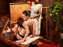 Woman having Ayurveda sauna. Royalty Free Stock Photos