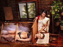 Woman having Ayurveda sauna. Stock Photo