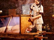 Woman having Ayurveda sauna. Royalty Free Stock Image