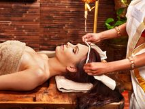 Woman having ayurveda spa treatment. Royalty Free Stock Photo