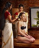 Woman having ayurveda spa treatment. Royalty Free Stock Image