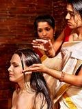 Woman having ayurveda spa treatment. royalty free stock photography