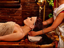 Woman having ayurveda spa treatment Royalty Free Stock Photo