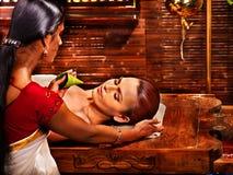 Woman having ayurveda spa treatment. Stock Photos