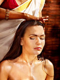 Woman having ayurveda spa treatment. Royalty Free Stock Photos