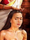 Woman having ayurveda spa treatment. Royalty Free Stock Photos