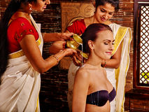 Woman having ayurveda spa treatment Royalty Free Stock Photography
