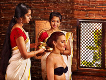 Woman having ayurveda spa treatment. Royalty Free Stock Images