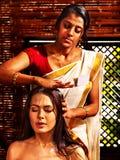 Woman having ayurveda spa treatment. Stock Image