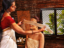 Woman having ayurveda spa treatment. Stock Photo