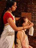 Woman having ayurveda spa treatment Stock Image