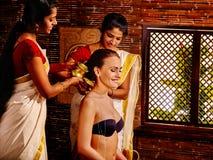 Woman having ayurveda spa treatment Stock Photos