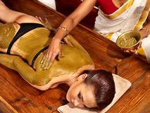 Woman having Ayurvedic body  spa massage. Royalty Free Stock Photos