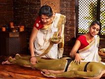 Woman having Ayurvedic body  spa massage. Stock Photography