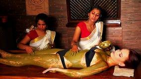 Woman having Ayurvedic body  spa massage stock video footage