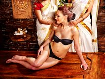 Woman having Ayurvedic body  spa massage. Stock Images