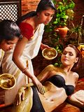 Woman having Ayurvedic body  spa massage. Stock Photo