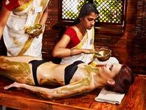 Woman having Ayurvedic body  spa massage. Young woman having body Ayurveda spa massage Stock Photography