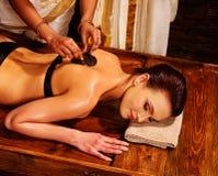 Woman having Ayurvedic body  spa massage Royalty Free Stock Images