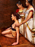 Woman having Ayurvedic body  spa massage. Royalty Free Stock Image