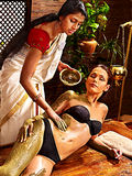 Woman having Ayurvedic body  spa massage. Stock Photography