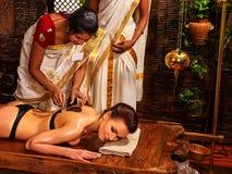 Woman having Ayurvedic body  spa massage. Royalty Free Stock Photos
