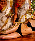 Woman having Ayurvedic body  spa massage Stock Images