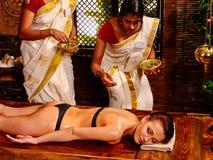 Woman having Ayurvedic body  spa massage. Stock Images