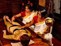 Woman having Ayurvedic body  spa massage Royalty Free Stock Photos