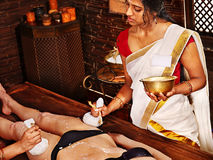 Woman having Ayurvedic feet spa massage. Stock Photos