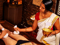 Woman having Ayurvedic feet spa massage Stock Images