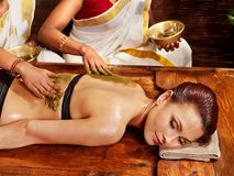 Woman having Ayurvedic spa massage. Stock Image