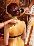 Woman having Ayurvedic spa treatment. Royalty Free Stock Image
