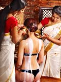 Woman having Ayurvedic spa treatment. Royalty Free Stock Image
