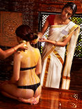 Woman having Ayurvedic spa treatment. Royalty Free Stock Photo