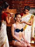 Woman having Ayurvedic spa treatment. Royalty Free Stock Photos