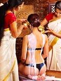 Woman having Ayurvedic spa treatment. Stock Photo