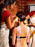 Woman having Ayurvedic spa treatment. Royalty Free Stock Photos