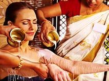Woman having Ayurvedic spa treatment. Royalty Free Stock Photography