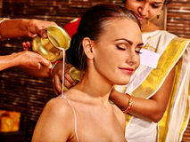 Woman having Ayurvedic spa treatment Stock Photography