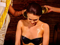 Woman having Ayurvedic spa treatment Royalty Free Stock Image