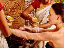 Woman having Ayurvedic spa treatment Stock Images