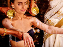 Woman having Ayurvedic spa treatment Royalty Free Stock Images