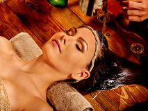Woman having Ayurvedic spa treatment Stock Photo