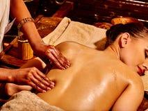 Woman having Ayurvedic spa treatment Stock Photo