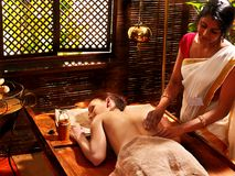 Woman having Ayurvedic spa treatment. Stock Image