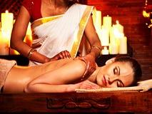 Woman having Ayurvedic spa treatment. Stock Photos