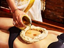 Woman having Ayurvedic spa treatment. royalty free stock images